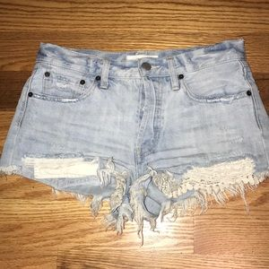 Frayed denim shorts with lace detailing